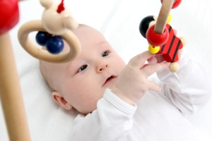 baby-playing-with-toys