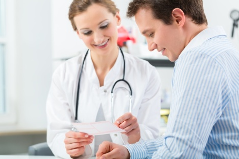 Female doctor with her patient in a consultation in clinic explaining something