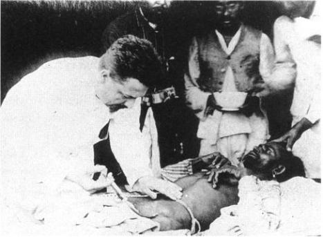 Paul-Louis_Simond_injecting_plague_vaccine_June_4th_1898_Karachi